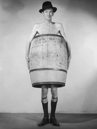 naked man with barrel