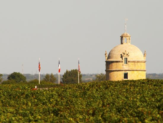 Tower and Flags of Chateau Latour Vineyard in Pauillac, France